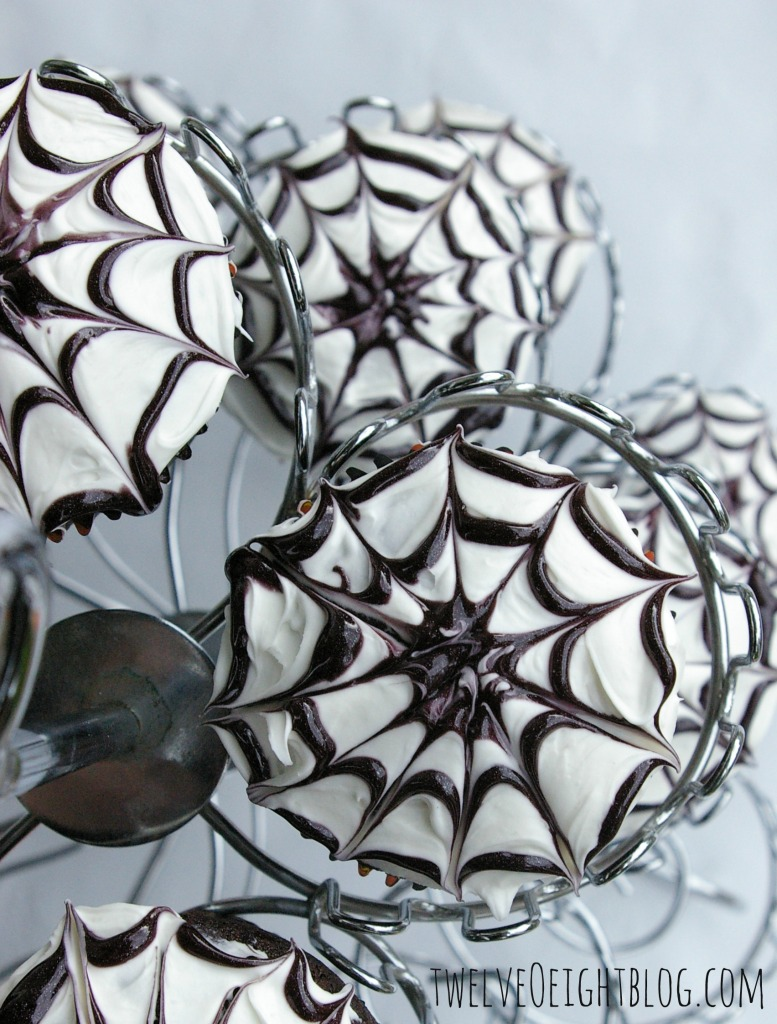 How To Make Spiderweb Cupcakes via twelveOeightblog.com #cupcake #Halloween #SpiderwebCupcake